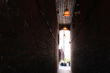 old lamp with narrow alley