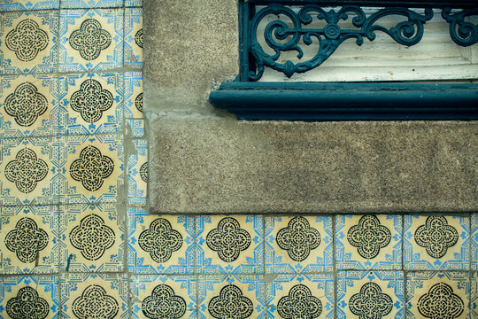 Traditional old tiles wall of building on street painted tin-glazed, azulejos ceramic tilework. Porto, Portugal.