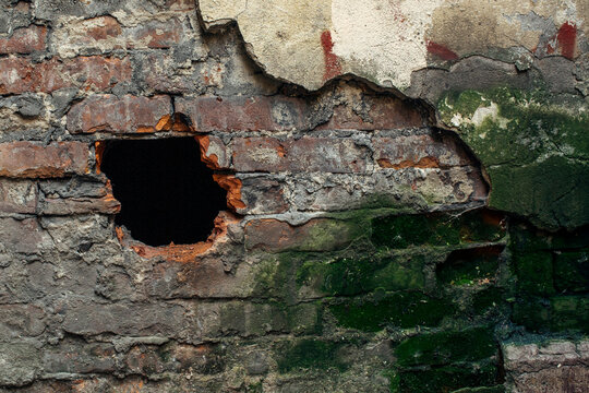 Abandoned house. Texture of old brick wall with broken plaster.