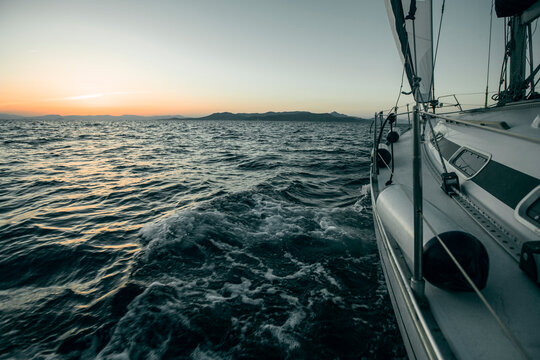 Sailing ship luxury yacht boat in the Sea during sunset.