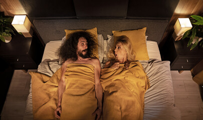 Young funny couple in a bed