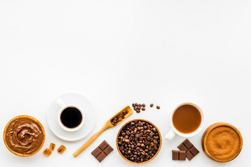 Background with assorted coffee and cocoa - beans with powder and hot drink