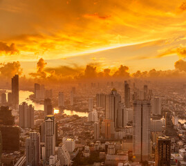 Fototapeta Golden Sunset Bangkok city of cityscape skyline with skyscraper building background in Central business district Bangkok, Thailand