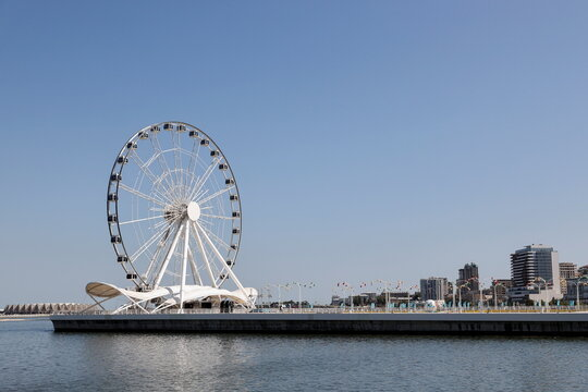 A general view shows a ferry wheel on an embankment of the Caspian Sea in Baku