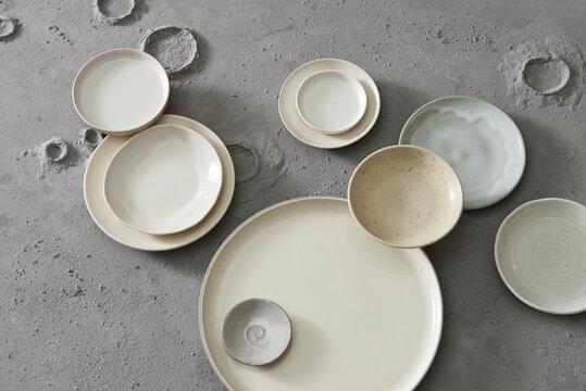 Ceramic tableware on grey background