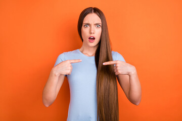 Photo of stressed long hairdo millennial lady point herself wear blue t-shirt isolated on vivid...