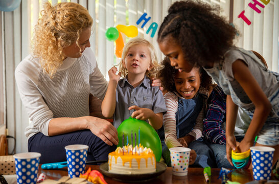 Boy celebrating birthday at home with his friends
