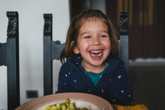 Happy Girl Having Lunch at Home