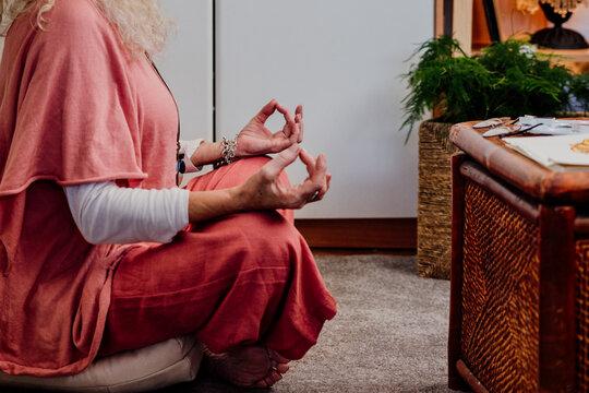 senior woman doing yoga at home