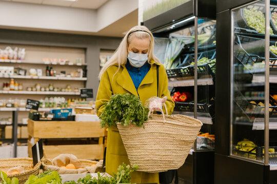 senior woman shopping bio snacks fruits