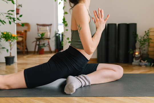 Close up image of a young woman practice yoga at home