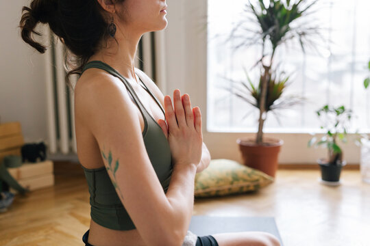 Close up image of a young woman who meditates during a yoga class
