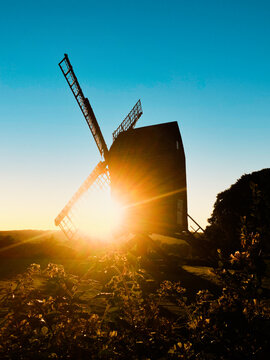 Old traditional windmill silhouette at sunset