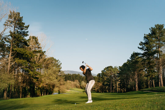 Woman playing golf in park
