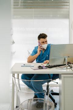 Veterinarian speaking on smartphone in clinic