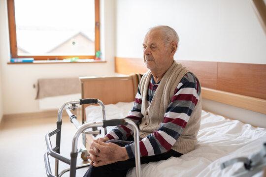 Senior Patient With Walker In Ward