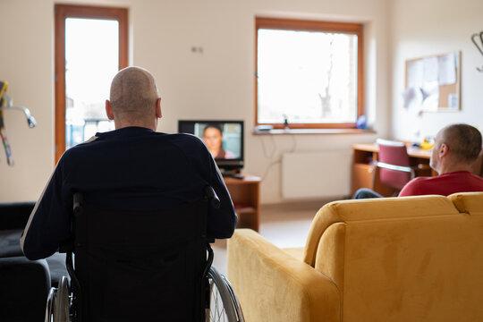 Two Man Watching Tv At Nursing Home