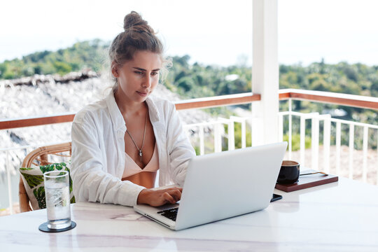 Woman Working In Cafe Outdoor With Laptop