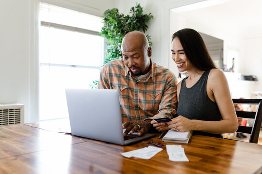 Couple Looks at Online Banking