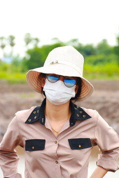 Close-up of a beautiful girl with a stethoscope of a doctor wearing a surgical mask