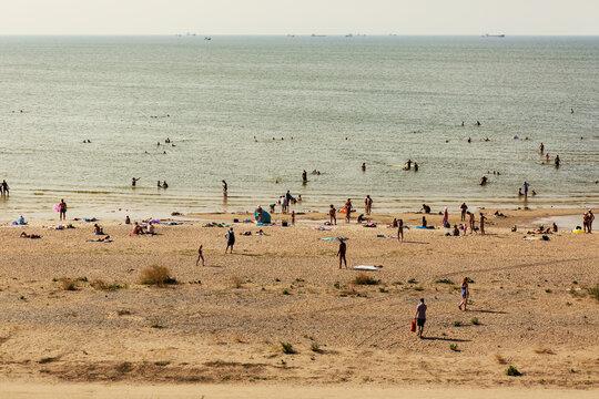 RUSSIA, YEYSK - 21 August 2016: Tourists in the Kamenka beach. Russia, Sea of Azov, Krasnodar Territory, Yeysk.