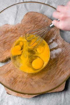 Lemon pie cooking. Eggs whisking