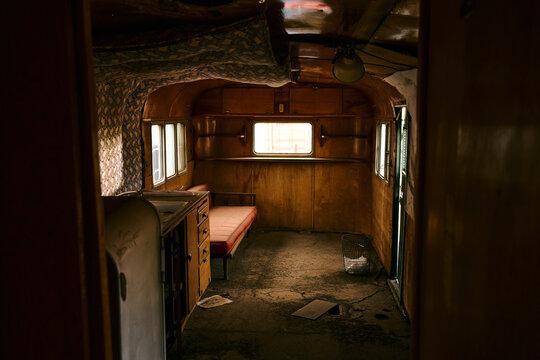 Abandoned 50s caravan at US countryside.