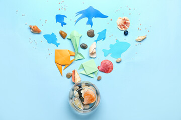 Fototapeta Aquarium with paper fishes and sea shells on color background. Ecology concept obraz