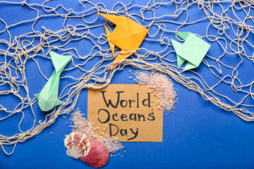 Fototapeta Text WORLD OCEAN DAY and paper fishes with net on color background obraz
