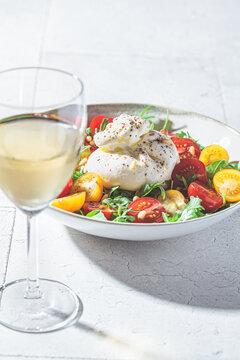 Burrata salad with white wine.
