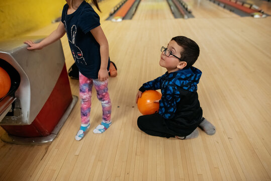 Kids partying at the bowling alley.