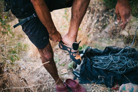 Faceless man wearing climbing shoes