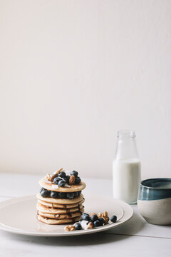 Still Life Of Homemade Organic Pancakes With Blueberries And Milk