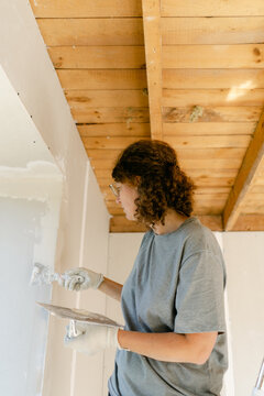 woman working on home renovation project