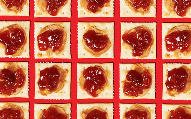 Arrangement of Soda Crackers with Peanut Butter and Jam