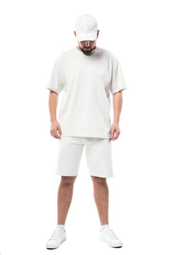 Man wearing blank white cap, t-shirt and shorts on white background
