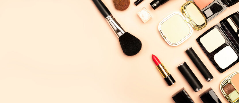 Professional Decorative Cosmetics, make-up products and accessories on nude pink background, minimal style. Beauty, fashion, visage and shopping blogger concept. Copy space banner