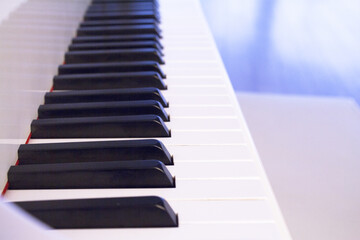 Part of the keyboard of a piano in white color