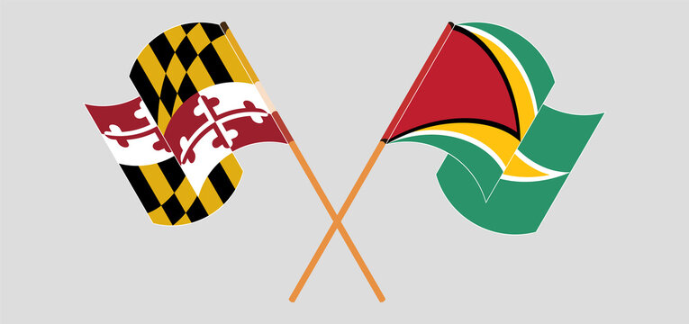 Crossed and waving flags of the State of Maryland and Guyana