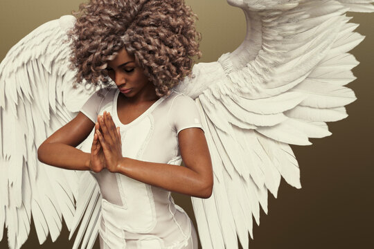 African american woman with white angel wings