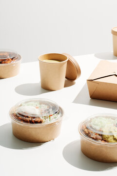 Cup of coffee and food in cardboard containers