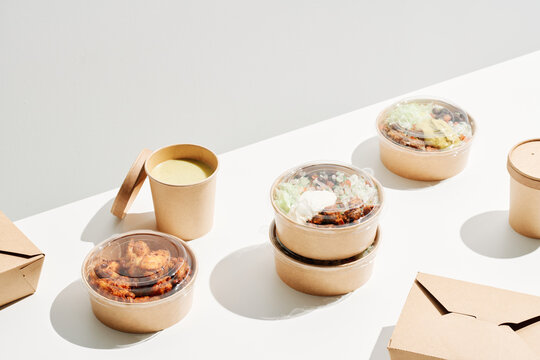Takeaway food in disposable containers on table