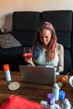Single mother browsing laptop at home
