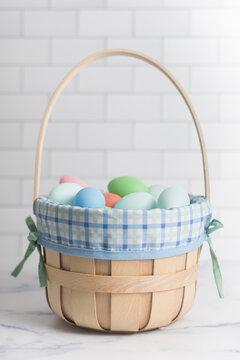 Basket of pastel Easter eggs