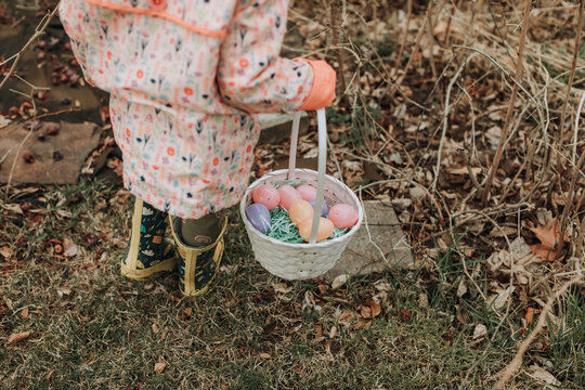 Young Child Hunting for Easter Eggs in Backyard