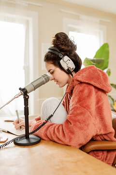 woman preparing notes for a podcast