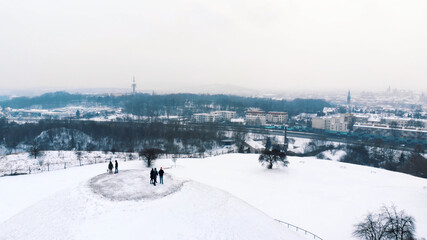 Fototapeta Aerial view of the Krakus Mound (Kopiec Krakusa) also called Krak Mound. A tumulus located in the Podgórze district of Kraków, Poland. Tourists can be seen standing. Whole area covered with snow.  obraz