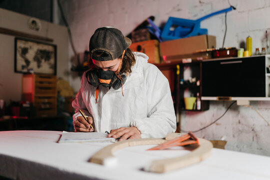 Young man working at his workshop