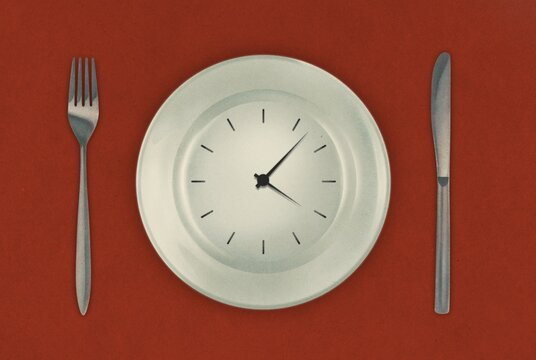Watch on a plate with cutlery illustration