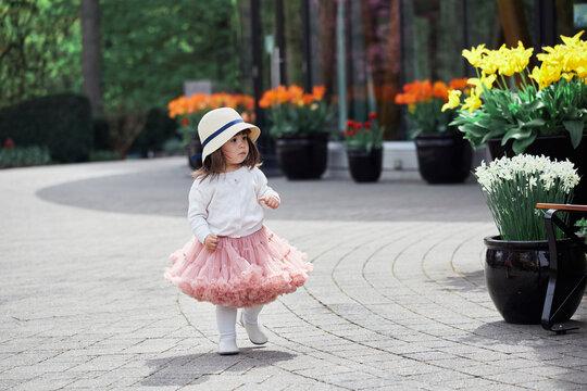 Cute Asian Toddler Exploring A Garden